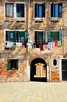 House facade with hanging clothes in Campo Santa Maria square - sestiere Dorsoduro, Venice - Italy.