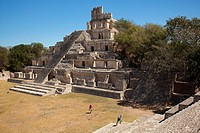 Visitors in front of the Edificio de los Cinco Pisos building at Gran Acropolis in Edzna Mayan Archeological site, Campeche State, Mexico, Central Ame...