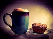 Fresh muffin and a cup of frothy cappuccino, Ontario, Canada