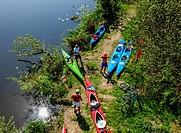 Poland, Warmian-Masurian Voivodeship, Elblag, Kayaks by the Druzno Lake.