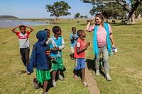 Local Ethiopian Boys Chatting To A Female Tourist, Lake Ziway, Ethiopia.
