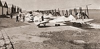 A line up of planes of the Royal Flying Corps which went into action in 1914. From The Story of 25 Eventful Years in Pictures published 1935.