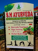 advertisement board for ayurvedic massage at beach in kovalam, kerala, india