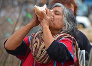 woman blows conch shell, New Mexico.