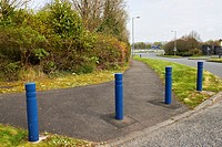 security bollards and grass earth berm protecting footpath in secure commercial area Newtownabbey UK these installations were common designs in the tr...