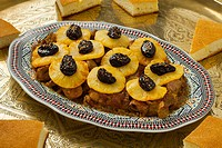 Moroccan dish with meat, pineapple,prunes and bread.