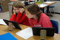 6th Grade Girls Using iPad for Lesson, Wellsville, New York, USA.