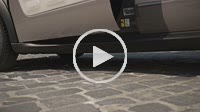Slender lady legs in high heels getting out of car
