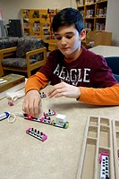 7th Grade Boy Working With Circuits, Wellsville, New York, USA.