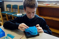 6th Grade Boy Working With Circuits, Wellsville, New York, USA.