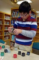 6th Grade Boy Working With Robotics, Wellsville, New York, USA.