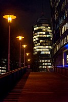 Illuminated building and pier at night in HafenCity, Hamburg, Germany.