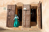 Meknes, Morocco. Woman Exiting a Shopping Area.
