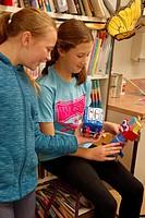 6th Grade Girls Building Robot in Art Class, Wellsville, New York, USA.
