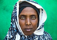 Portrait of an Afar tribe woman with green eyes and tattoos on her face, Afar region, Assaita, Ethiopia.
