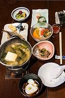 Multi course traditional breakfast at onsen resort, Hakone, Japan.