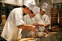 Chefs prepare dumplings at Chinese restaurant in Roppongi, Tokyo, Japan.