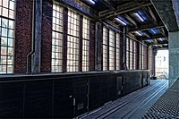 New York City, Manhattan, High Line Park. Looking North in the Chelsea Marketplace Passage at Original Railroad Tracks and Old Windows, Once a Train L...