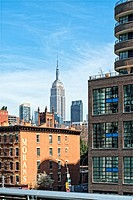 New York City, Manhattan. Looking Northeast from the High Line. Top of the Empire State Building in the Distance.