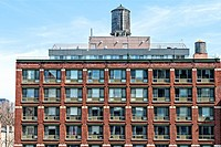 New York City, Manhattan. Partial View of an Apartment Building, converted and reclaimed from an old commercial space. New Penthouse constructed on th...