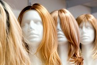 Row of Mannequin Heads with Wigs on the Shelf.