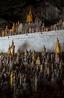 Thousands of Buddha statues are in the Tham Ting (lower cave) of the Pak Ou Caves, situated in a limestone mountain above the Mekong River near Luang ...