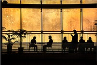 Passengers waiting for flights at Haneda Airport, Tokyo, Japan.