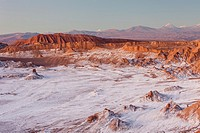 Valle de la Luna (Valley of the Moon ), in background Andes Mountains with snow on top , and salt deposited on the nearest mountains and ground, Ataca...