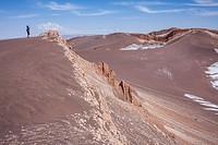 Trekking, in Valle de la Luna (Valley of the Moon ) and salt deposited on the ground, Atacama desert. Region de Antofagasta. Chile.