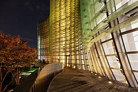 The National Art Center Tokyo exterior in the evening, Roppongi, Tokyo, Japan (architect Kisho Kurokawa).