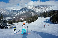 Young girl and boy skiing at italian Alps, Bormio, Italy