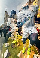 Mannequins and reflections at Real Madrid Official Store window shop at Gran Via street. Madrid. Spain.
