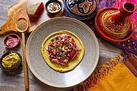 Humus with marinated tuna Moroccan recipe on wooden table.