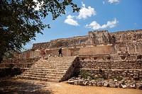 Tourists climbing up the stairs leading to the stone carved Atlantes figures on the back of the Palace Of The Masks-El Palacio de las Mascarones in Ma...