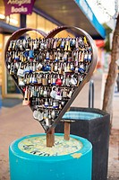 Tucson, Arizona - Lock Your Love sculpture on Fourth Avenue. Sweethearts inscribe their names on a local, place it on the sculpture, and throw away th...