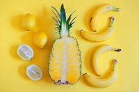 Fruits from above on yellow background.