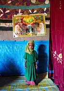 Girl in front of a muslim poster inside her house, Kembata, Alaba Kuito, Ethiopia.