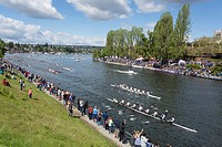 Seattle, Washington: Spectators gathered on the shore of Montlake Cut at the Windermere Cup Crew Race during Opening Day of Boating Season.