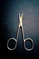 Nail scissors on a black background