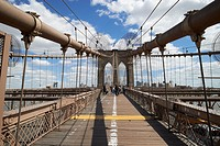 walking across the brooklyn bridge New York City USA.