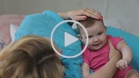 Loving mother stroking adorable baby girl head