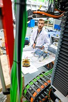 Researcher working on portable robot to drill holes into aircraft components, Industry, Research and Technology Center, Tecnalia Research & Innovation...