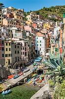 Village of Riomaggiore a popular tourist destination at the Parco Naturale Cinque Terre at the Ligurian Coast, Italy.