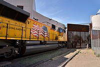 A train hauling mostly manufactured automobiles stops in Nogales, Sonora, Mexico, to be processed before entering a metal gate at the Dennis DeConcini...