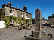 The Boars Head Pub and War memorial in the Market Place at Ripley North Yorkshire England.