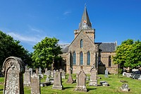 Old tombstones at cemetery of the 13th century Dornoch Cathedral, parish church in the Church of Scotland, Sutherland, Scottish Highlands, Scotland