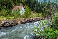An old barn stands by Canyon Creek near Wallace, Idaho.