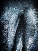 Scary shadow on old grave stone in church. Concept of death, crime and horror.