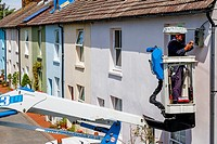 An Electrician Repairs A Street Light, Lewes, East Sussex, UK.