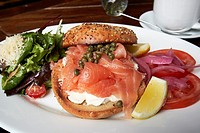 bagel with cream cheese and smoked salmon lunch with coffee in a restaurant in New York City USA.